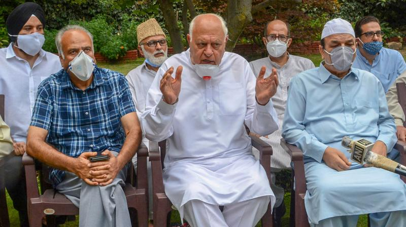 National Conference President Farooq Abdullah addresses a press conference after holding a meeting with party leaders, including those leaders who were detained post-August 05, 2019 and released recently, at his residence in Srinagar. (PTI)