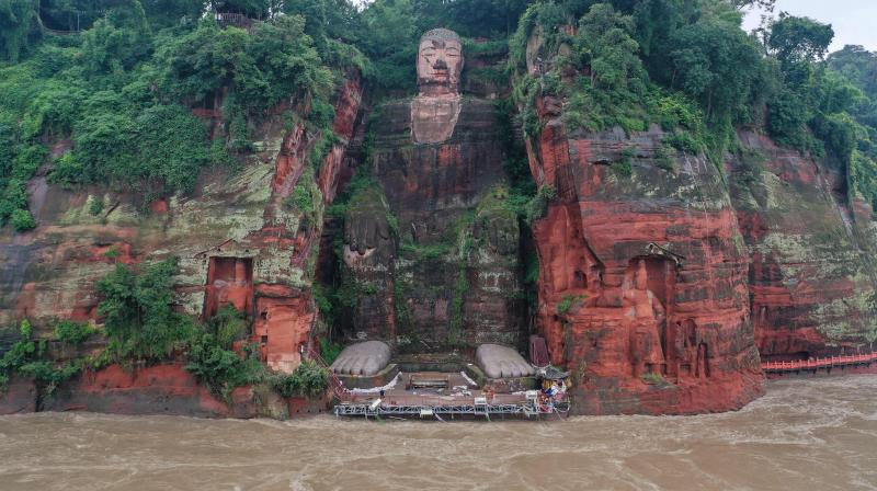 The Leshan Giant Buddha surrounded by floodwaters following heavy rains in Leshan in China's southwestern Sichuan province. (AFP)