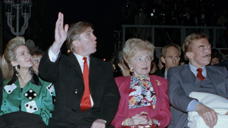 Donald Trump (second from left) waves to staff members of the Trump Taj Mahal Casino Resort as they cheer him on before the grand opening ceremonies in Atlantic City. Trump attended the gala with his mother, Mary; father, Fred; and sister, U.S. District Court Judge Maryanne Trump Barry. (AP File)