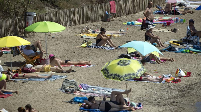 Beachgoers enjoy a hot day in the sun at a beach in Bormes-les-Mimosas, southern France. (AP File)