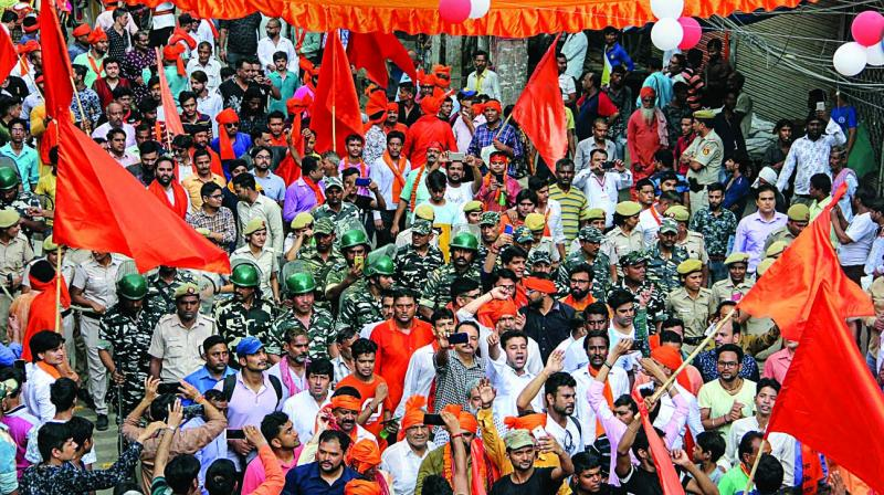 """VHP workers hold a """"shobha yatra"""" in the Hauz Qazi area in Old Delhi on Tuesday. (Photo: PTI)"""
