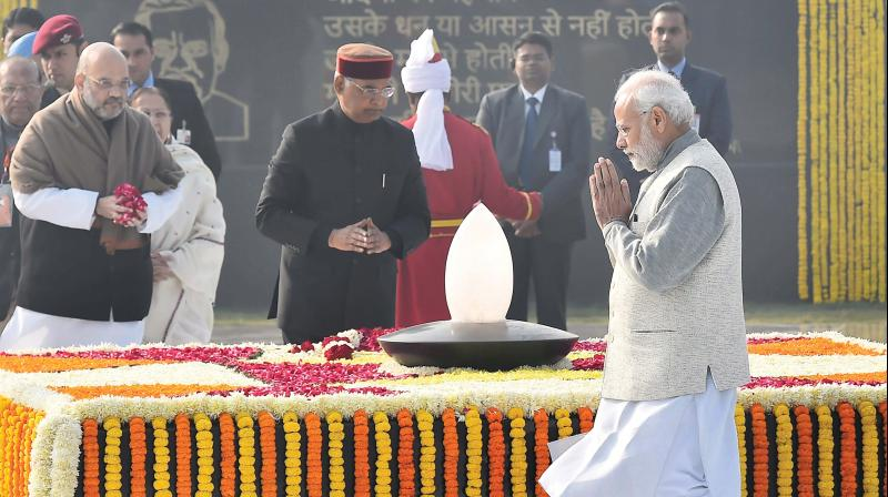Prime Minister Narendra Modi pays homage to former PM Atal Behari Vajpayee on his 94th birth anniversary in New Delhi on Tuesday. President Ram Nath Kovind and BJP chief Amit Shah are also seen. (Photo: PTI)