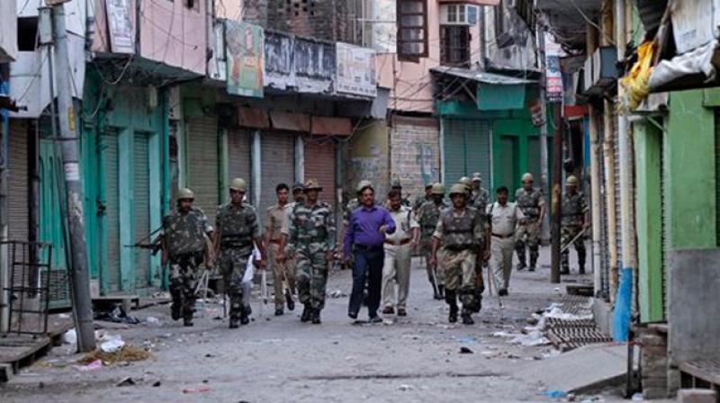 Officials and security forces patrol during an army-enforced curfew imposed following deadly clashes between Hindus and Muslims at Muzaffarnagar. (AP/File)
