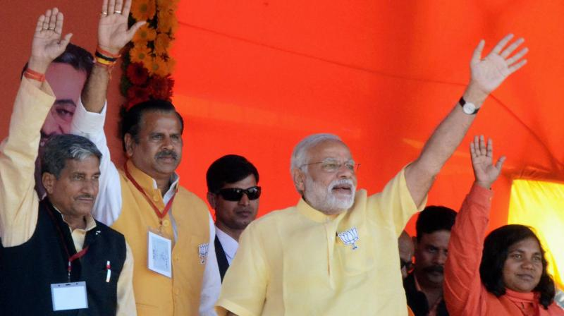 Prime Minister Narendra Modi waves at an election campaign rally in Bahraich district. (Photo: PTI)