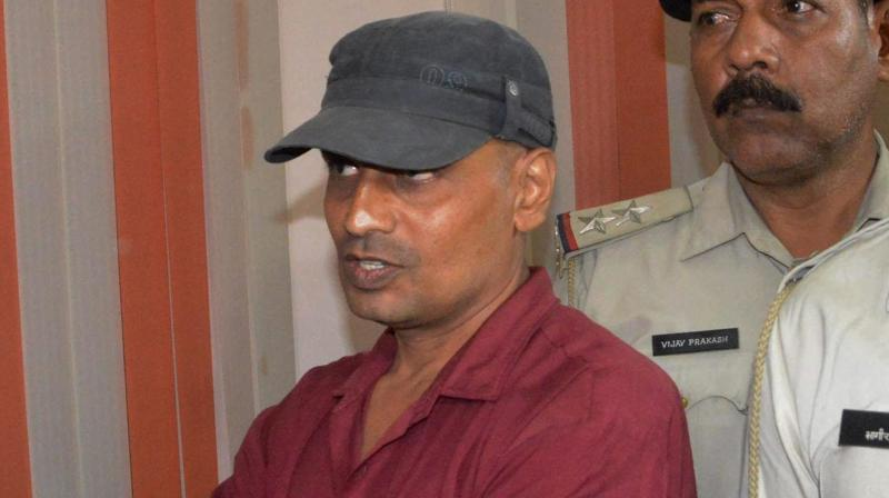 Bihar board 'topper' Ganesh Kumar being arrested after the Bihar School Examination Board (BSEB) cancelled his result, in Patna. (Photo: AP)