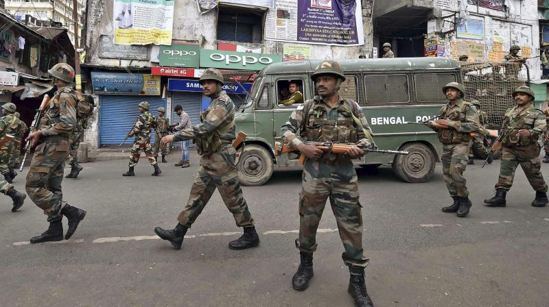 Security personnel patrol a road during GJM strike in Darjeeling. (Photo: AP)