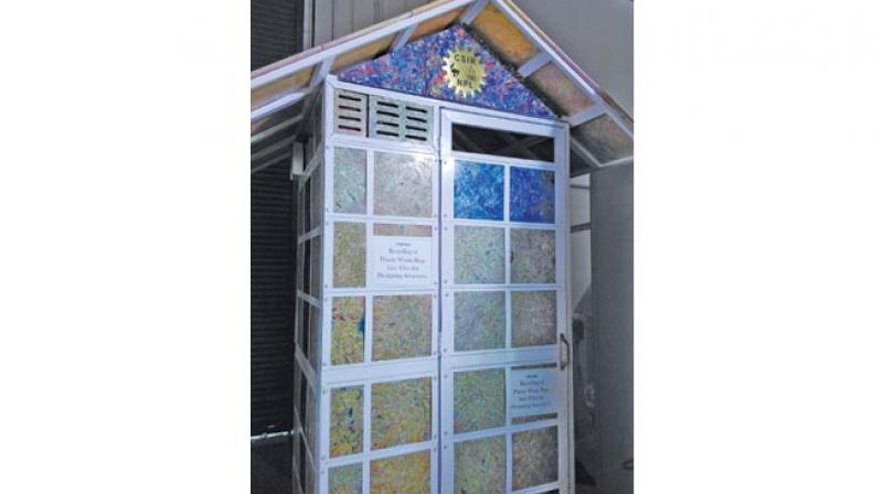 A portable toilet cabin built using tiles made of recycled polythene bags.