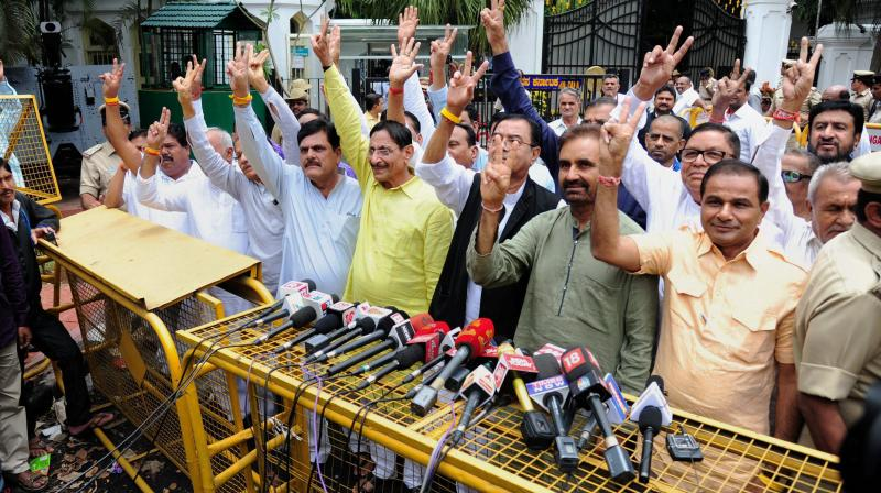 Gujarat Congress MLA's comes out of Rajbhavan after meeting with Governor in Bengaluru. (Photo: PTI)