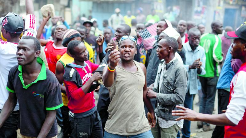 Protesters of Kenya opposition leader Raila Odinga demonstrate in the Mathare area of Nairobi, Kenya. (Photo: AP)