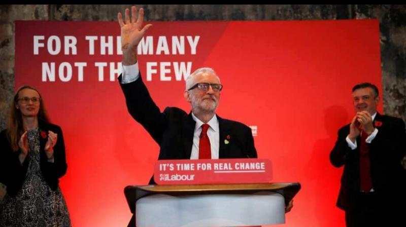 Britain's opposition Labour Party leader Jeremy Corbyn waves to supporters at a launch event for the Labour party's general election campaign in London, Britain. Photograph:(Photo: AFP)