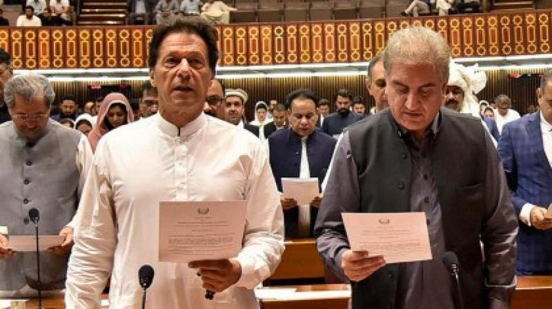 After the swearing-in ceremony at the President House, Qureshi (right) went to Pakistan's ministry of foreign affairs to address the media.