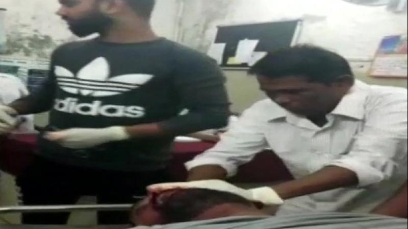 The sweeper (right, in white shirt) in question was involved in a similar incident three months ago when he was filmed giving stitches to another patient. (Photo: ANI)