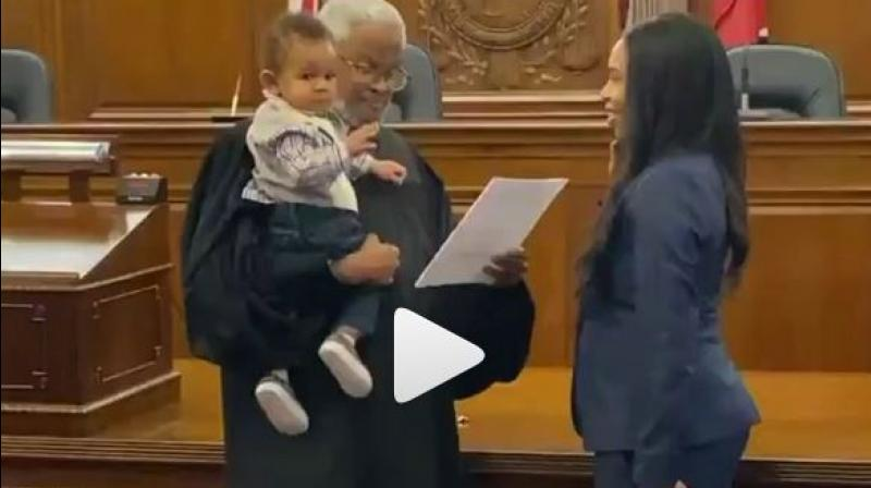 One such video is making rounds on social media, where a lady was being sworn in as a lawyer while the judge held her baby, and it is, undoubtedly, winning hearts. (Photo: Screengrab)