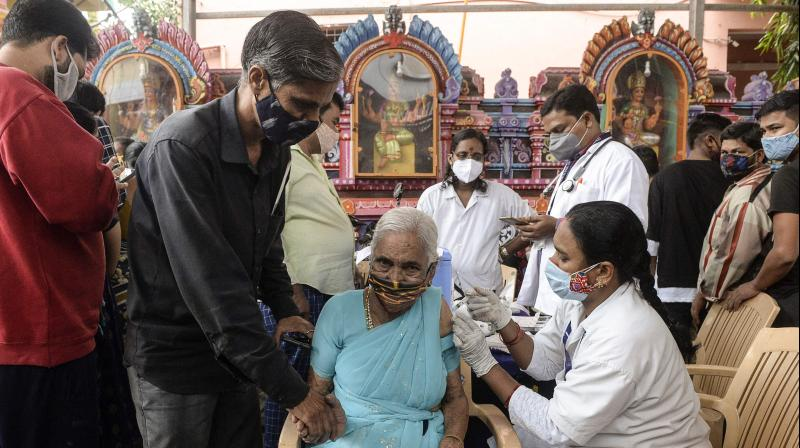 A health worker inoculates a woman with a dose of the Covishield vaccine against the Covid-19 coronavirus during a vaccination drive in Hyderabad. (AFP)