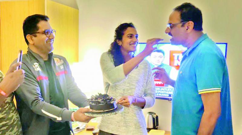 Sindhu and her father Ramana celebrating with Hyderabad Hunters team on Saturday.