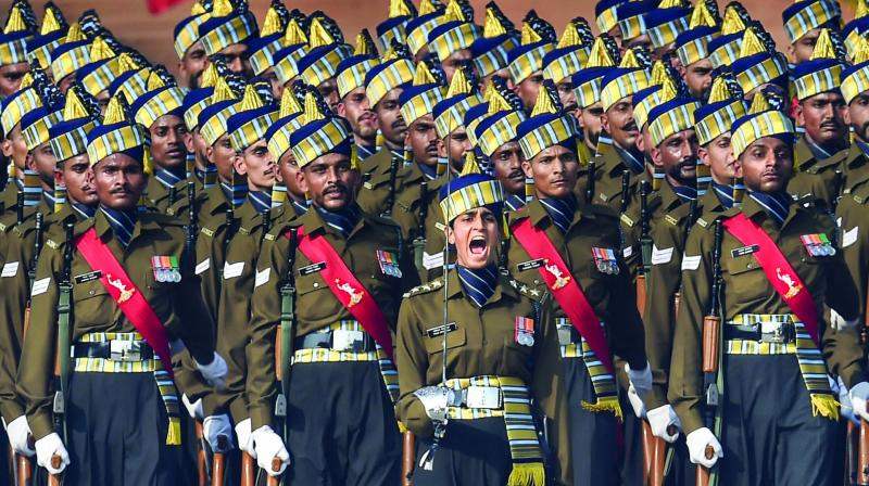 Indian Army Corps of Signals contingent led by Capt. Tanya Shergil marches during the 71st Republic Day Parade at Rajpath in New Delhi on Sunday.