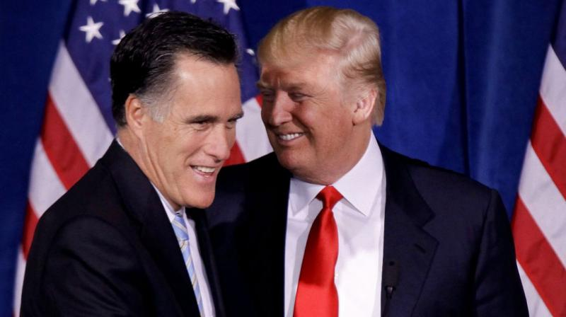 US President-elect Donald Trump and his former bete noire Mitt Romney. (Photo: AP)
