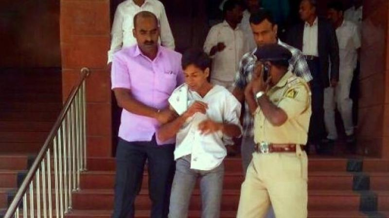 Attacker Tejas Sharma who stabbed the Karnataka Lokayukta Justice Vishwanath Shetty at his office in Bengaluru has been taken into custody by the police. (Photo: ANI   Twitter)