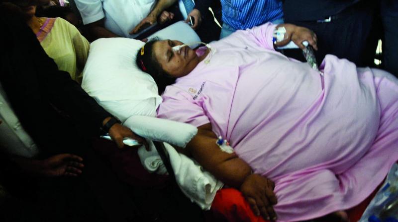 Egyptian national Eman Ahmed is carried on a stretcher towards an ambulance on Thursday. (Photo: Shripad Naik)
