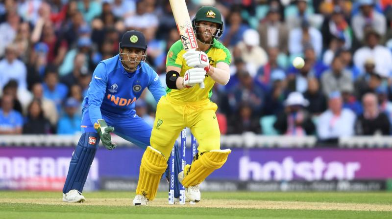 Australia opener David Warner became the fifth batsman at the World Cup to get an unexpected reprieve after he dragged a ball on to his stump but the impact failed to dislodge the zing bails in Sunday's match against India. (Photo:AFP)