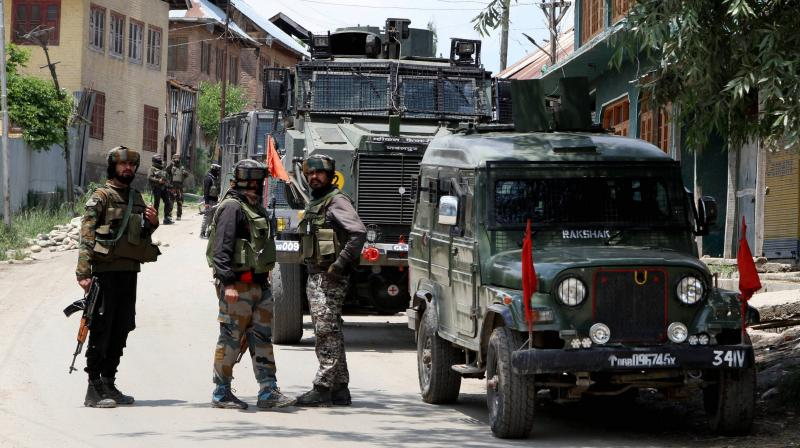 Security forces jawans stand guard during an encounter with the militants in the Kangan area of Pulwama district of south Kashmir. PTI photo