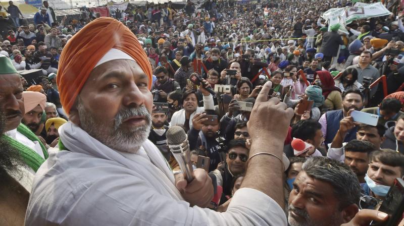 Bharatiya Kisan Union spokesperson Rakesh Tikait addresses a protest over Centre's farmlaws at Ghazipur border in New Delhi on Saturday. — PTI
