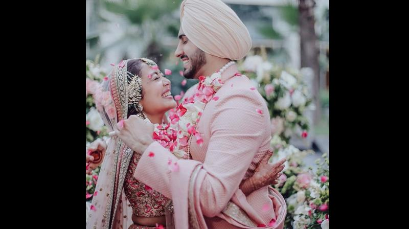 uncanny similarities: Neha's wedding outfit — with hues of pink and peaches, which she wore on her Gurudwara wedding had uncanny resemblance to the outfit Anushka Sharma had worn for her wedding reception