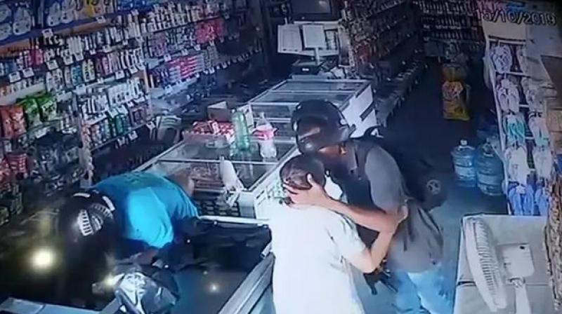 'He kissed her and said, 'No, ma'am, you can be quiet, I don't want your money,' shop owner said. (Photo: Screengrab)