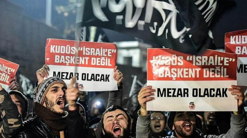 Pro-Palestinian protesters also held Muslim prayers outside the Hagia Sophia, a former Byzantine church that was turned into a mosque after the Ottoman conquest of Istanbul but is now a museum. (Photo: AFP)