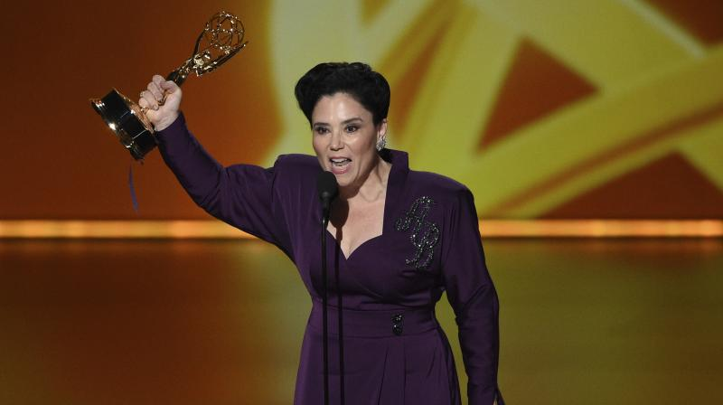 Alex Borstein wore a demure deep purple gown when collecting her Emmy. It has her initials embellished on the top left hand corner. (Photo: AP)