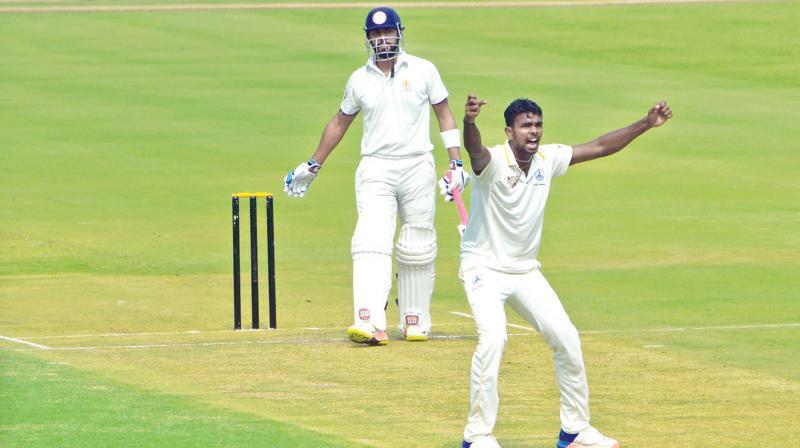 Tamil Nadu bowler Aswin Crist appeals for the wicket of Karnataka Stuart Binny on Day One of their Ranji Trophy quarter-final at Vizag. (Photo: K. Murali Krishna)