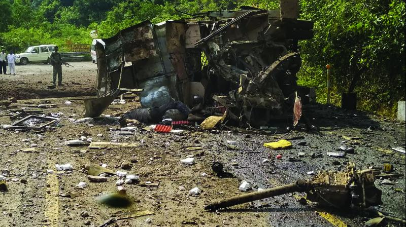 The mangled remains of a CISF minibus after an IED blast, allegedly triggered by the Maoists, in Bacheli area of Dantewada, Chhattisgarh. (Photo: PTI)