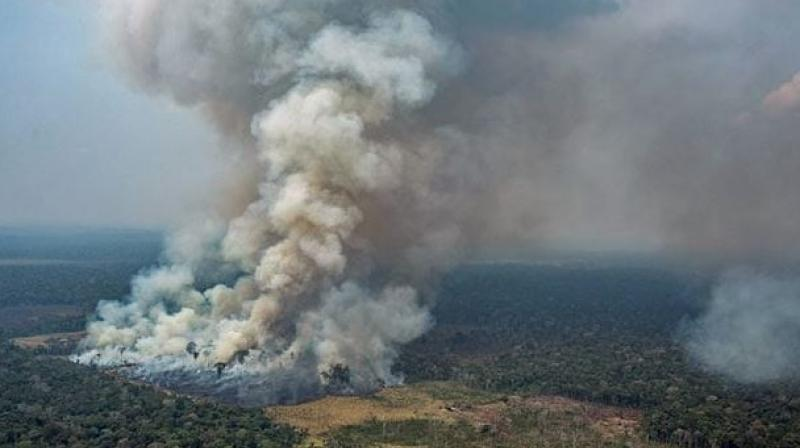 Tensions have risen between France and Brazil after Macron tweeted that the fires burning in the Amazon basin amounted to an international crisis and should be discussed as a top priority at the G7 summit. (Photo: AFP)