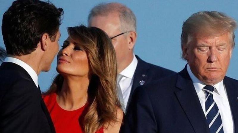 Melania Trump's husband, US President Donald Trump, stands by her with downcast eyes. (Photo: Twitter)