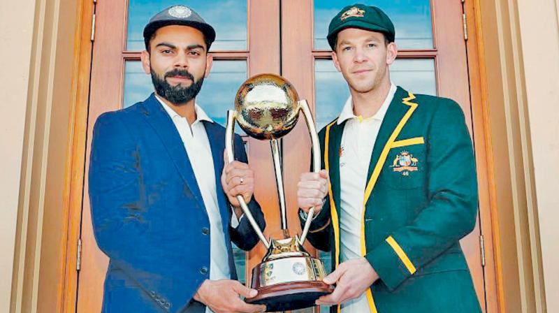 Australian Test captain Tim Paine and his Indian counterpart Virat Kohli with the Border Gavaskar Trophy. DC File Photo
