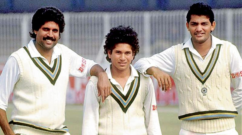 Mohammad Ahzaruddin with young Sachin Tendulkar and Kapil Dev. DC File Photo