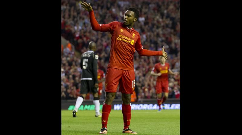 Liverpool's Daniel Sturridge celebrates after scoring a goal. AP Photo