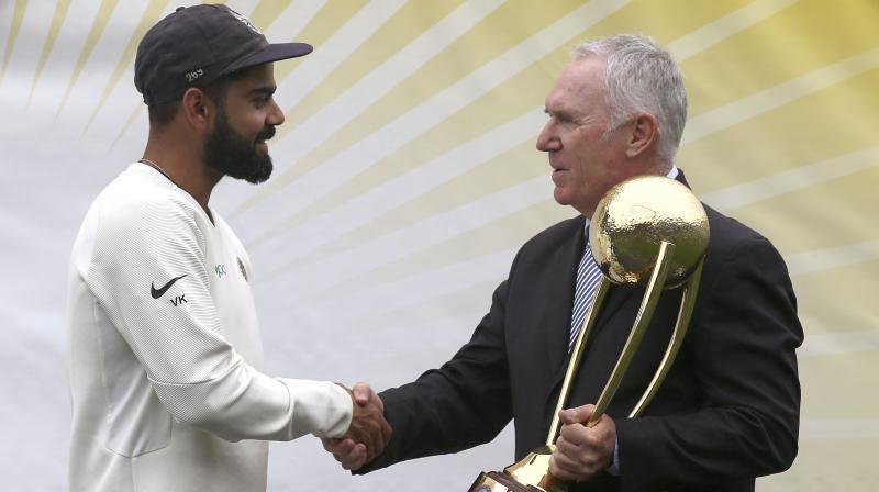 Former Australia cricket captain Allan Border (R) with Virat Kohli. DC File Photo