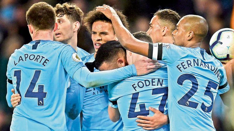 Manchester City's German midfielder Leroy Sane (3L) celebrates his goal against Cardiff City with his teammates. AFP Photo