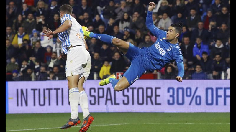 Juventus' Cristiano Ronaldo tries an acrobatic kick during an Italian Serie A match against Spal at the Paolo Mazza stadium in Ferrara, Italy. AP Photo