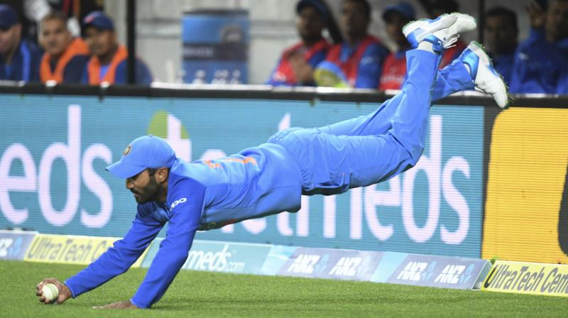 Dinesh Karthik takes an acrobatic catch to dismiss New Zealand's Daryl Mitchell in the Twenty/20 international in New Zealand last year. AP Photo