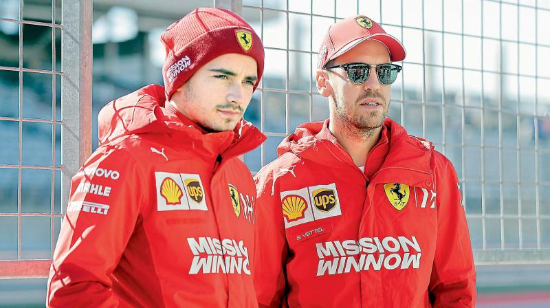 Ferrari teammates Charles Leclerc (L) and Sebastian Vettel. DC File Photo
