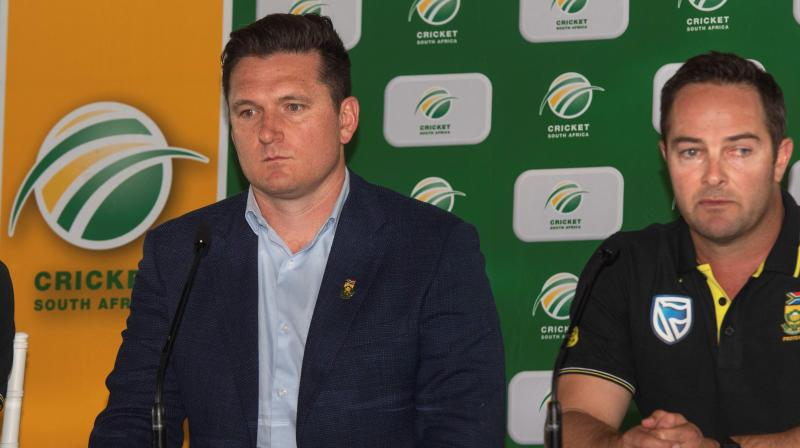 Former captain of South Arica cricket team Graeme Smith (L) with head coach Mark Boucher. AFP Photo.