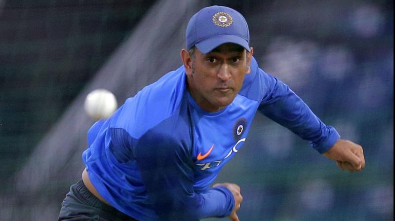 MS Dhoni tries his hand at bowling in the nets. AP Photo
