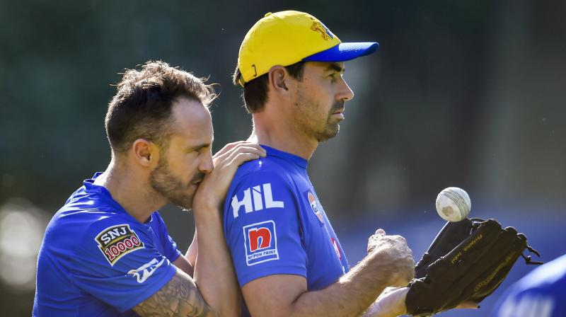 Chennai Super Kings coach Stephen Fleming (R) with Faf du Plessis. PTI Photo
