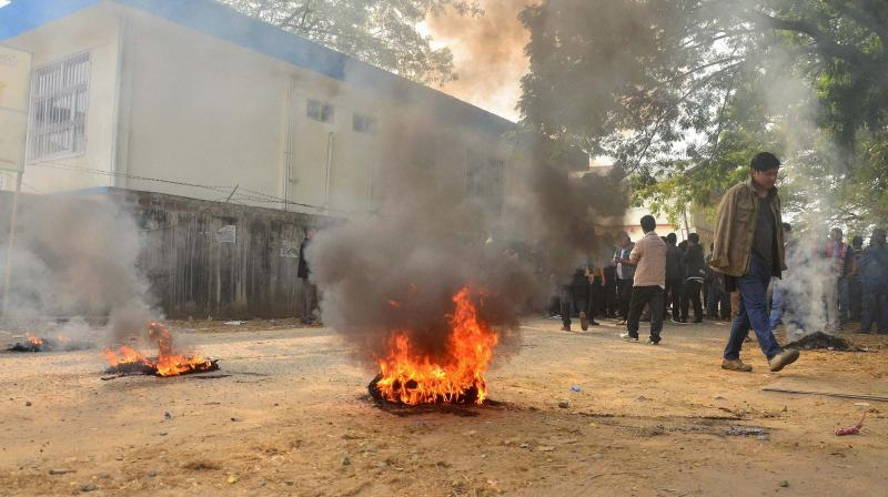 Protesters burn tyres on the road during a bandh called by Joint Coordination Committee against 33 per cent women reservation for the forthcoming Municipal and Urban Local Body election in Dimapur. (Photo: PTI)