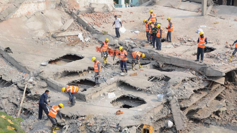 Rescue and relief works in progress at the site of the collapsed under-construction building in Chakeri, Kanpur. (Photo: PTI)