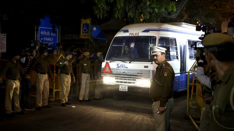 CBI vehicle carrying Former Air Force chief S.P. Tyagi comes after he along with other accused were produced in a Delhi court in New Delhi. (Photo: PTI)