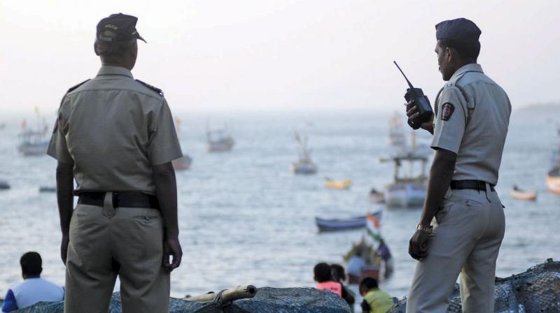 File picture of policemen on duty at Badhwar Park, near the spot where terrorists entered Mumbai via sea to carry out the 26/11 attacks.