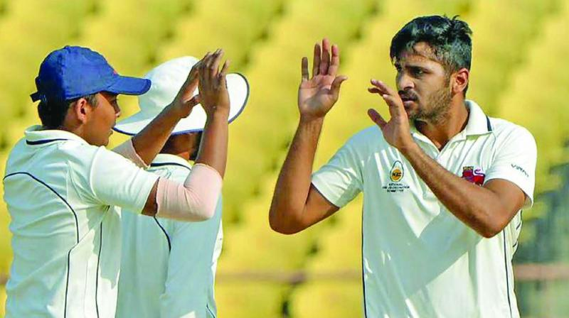 Mumbai medium pacer Shardul Thakur is being congratulated by Prithvi Shaw in a file pic.